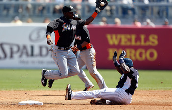 Ronnier Mustelier slides safely into second base during a March 15 Spring Training game against the Miami marlins
