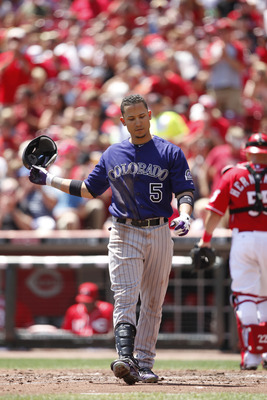 Carlos Gonzalez is a fantasy Superman at home. On the road, though, he's Clark Kent.
