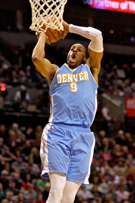 Feb 27, 2013; Portland, OR, USA; Denver Nuggets shooting guard Andre Iguodala (9) dunks against the Portland Trail Blazers at the Rose Garden. Mandatory Credit: Craig Mitchelldyer-USA TODAY Sports
