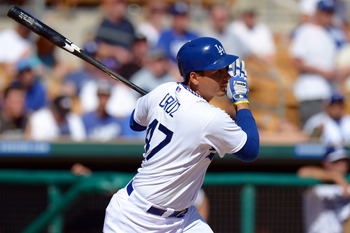 Luis Cruz will take over at shortstop while a caravan of players takes over at third for the Los Angeles Dodgers.