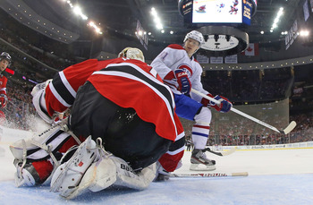 Montreal Canadien Lars Eller in front of New Jersey Devil Johan Hedberg.