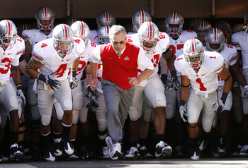 Jim Tressel is known for his sweater-vest and conservative style.