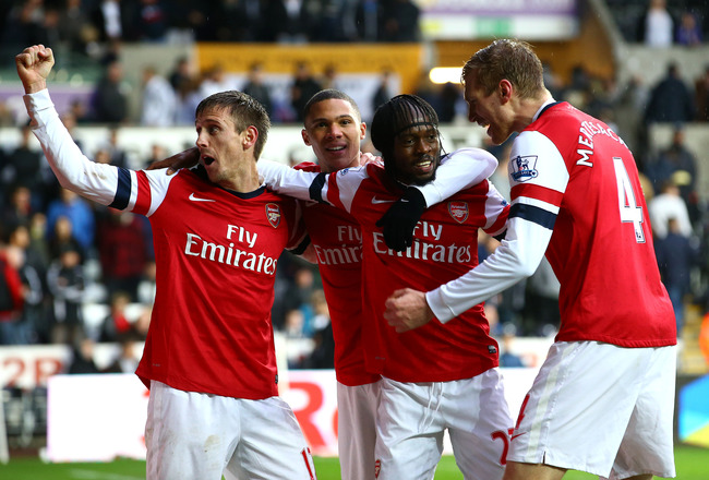 SWANSEA, WALES - MARCH 16:   Gervinho of Arsenal (2R) celebrates his goal with team mates during the Barclays Premier League match between Swansea City and Arsenal at Liberty Stadium on March 16, 2013 in Swansea, Wales.  (Photo by Jan Kruger/Getty Images)