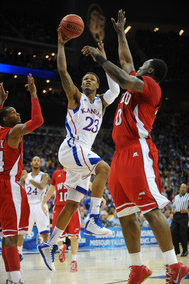 Mar 22, 2013; Kansas City, MO, USA; Kansas Jayhawks guard Ben McLemore (23) shoots as Western Kentucky Hilltoppers forward Kene Anyigbo (0) defends in the first half during the second round of the 2013 NCAA tournament at the Sprint Center. Mandatory Credi