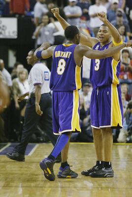 Kobe Bryant (left) and Devean George (right) celebrate the Game 7 victory in Sacramento in Western Conference Finals.