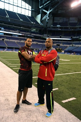 Ty Powell (No. 37, left) posing for a picture at combine.