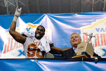 SAN ANTONIO, TX - DECEMBER 29:  Alex Okafor #80 of the University of Texas Longhorns celebrates as Defensive Player of the game against the Oregon State Beavers in the Valero Alamo Bowl at the Alamodome on December 29, 2012 in San Antonio, Texas.  Texas w