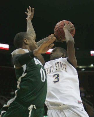 Armon Bassett contests Randal Holt's shot. (Karen Schiely/Akron Beacon Journal)