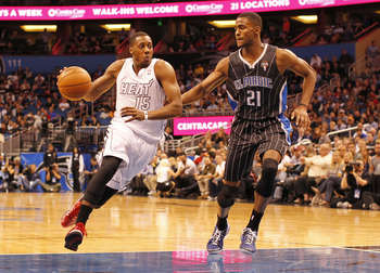 Mario Chalmers drives against Orlando's Maurice Harkless yesterday.