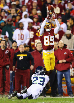 Santana Moss reels in a big catch against the Seahawks.