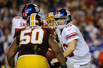 Rob Jackson eyes down Eli Manning as he goes in for the sack.