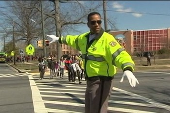 Former NBA star Adrian Dantley keeping streets safe for the kids.