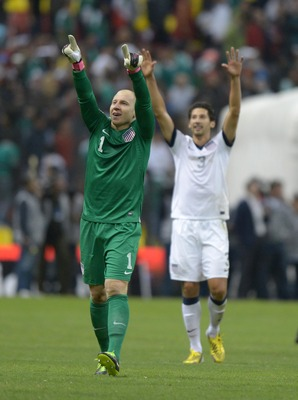 Gonzalez (right) celebrates the draw with Brad Guzan.