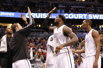 Heat teammates high five during a game against Orlando on March 25.
