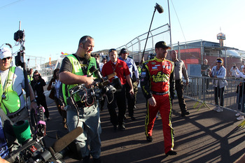 AVONDALE, AZ - NOVEMBER 11:  Clint Bowyer, driver of the #15 5-hour Energy Toyota, walks back to his car on pit road after an incident with Jeff Gordon (not pictured), driver of the #24 DuPont Chevrolet, during the NASCAR Sprint Cup Series AdvoCare 500 at