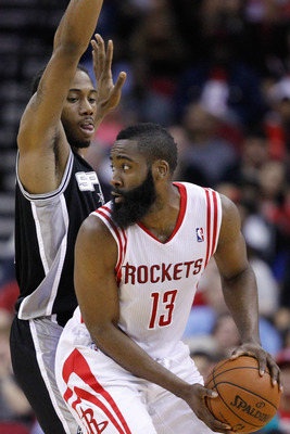 Mar 24, 2013; Houston, TX, USA; Houston Rockets shooting guard James Harden (13) posts up on San Antonio Spurs small forward Kawhi Leonard (2) during the second half at the Toyota Center. The Rockets won 96-95. Mandatory Credit: Thomas Campbell-USA TODAY