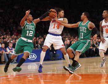 NEW YORK, NY - JANUARY 07: Chris Copeland #14 of the New York Knicks tries to keep the ball away from Leandro Barbosa #12 and Courtney Lee #11 of the Boston Celtics at Madison Square Garden on January 7, 2013 in New York City. NOTE TO USER: User expressly