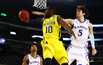 ARLINGTON, TX - MARCH 29:  Tim Hardaway Jr. #10 of the Michigan Wolverines goes up against Jeff Withey #5 of the Kansas Jayhawks in the second half during the South Regional Semifinal round of the 2013 NCAA Men's Basketball Tournament at Dallas Cowboys St