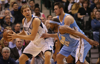 Danilo Gallinari (background) and Corey Brewer (foreground), SF