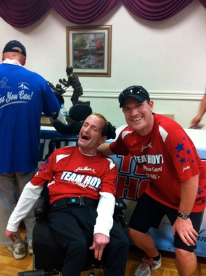 Dan Quinn, right, with Rick Hoyt at the Hoyt's 5K Road Race to be held this May in Hopkinton, MA
