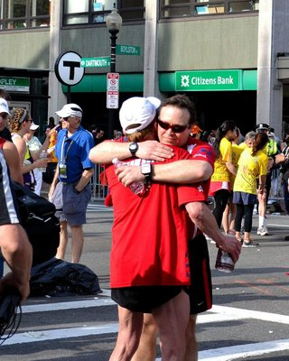 Bryan Lyons embraces his friend and idol, Dick Hoyt, following the 2012 Boston Marathon