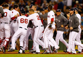 BOSTON, MA - SEPTEMBER 11:  Jacoby Ellsbury #2 of the Boston Red Sox is mobbed by his teammates following his walk-off RBI in the bottom of the ninth inning against the New York Yankees during the game on September 11, 2012 at Fenway Park in Boston, Massa