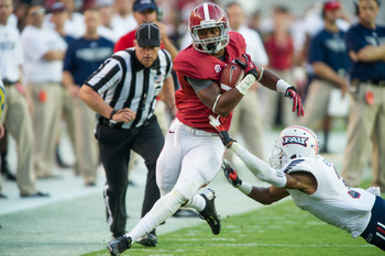 Kenyan Drake tries to stay in-bounds against Florida Atlantic.