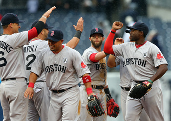 The Boston Red Sox celebrate their 8-2 Opening Day victory against the Yankees.