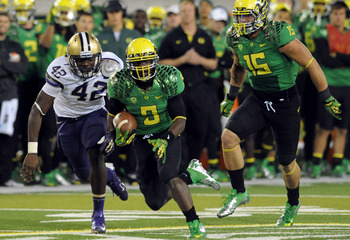 EUGENE, OR - OCTOBER 6: Running back Byron Marshall #9 of the Oregon Ducks runs past linebacker Cory Littleton #42 of the Washington Huskies during the fourth quarter of the game on October 6, 2012 at Autzen Stadium in Eugene, Oregon. Oregon won the game