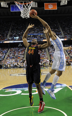 Mar 16, 2013; Greensboro, NC, USA; Maryland Terrapins center Shaquille Cleare (44) battles for a rebound with North Carolina Tar Heels forward James Michael McAdoo (43) during the semifinals of the ACC tournament at Greensboro Coliseum. Mandatory Credit: