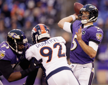Dumervil tries to sack new teammate Joe Flacco.
