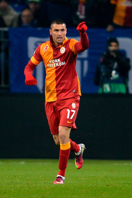 GELSENKIRCHEN, GERMANY - MARCH 12:  Burak Yilmaz of Galatasaray celebrates after scoring his team's second goal during the UEFA Champions League round of 16 second leg match between Schalke 04 and Galatasaray AS at Veltins-Arena on March 12, 2013 in Gelse