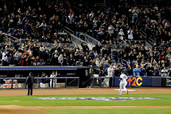 Andy Pettitte exits the field after starting Game 1 for the New York Yankees during the 2012 ALCS against the Detroit Tigers
