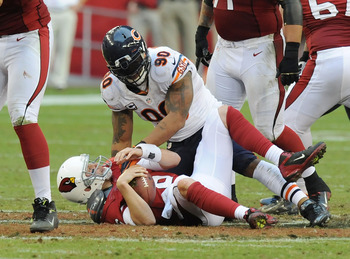 GLENDALE, AZ - DECEMBER 23:  Brian Hoyer #6 of the Arizona Cardinals is sacked by Julius Peppers #90 of the Chicago Bears at University of Phoenix Stadium on December 23, 2012 in Glendale, Arizona. Bears won 28-13. (Photo by Norm Hall/Getty Images)