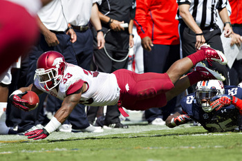 AUBURN, AL - OCTOBER 6:  Dennis Johnson #33 of the Arkansas Razorbacks dives for a first down against the Auburn Tigers at Jordan-Hare Stadium on October 6, 2012 in Auburn, Alabama.  The Razorbacks defeated the Tigers 24-7.  (Photo by Wesley Hitt/Getty Im