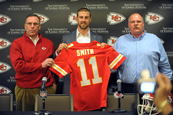 Mar 13, 2013; Kansas City, MO, USA; Kansas City Chiefs general manager John Dorsey (right), quarterback Alex Smith (center), and head coach Andy Reid pose for photos during the press conference at The University of Kansas Hospital Training Complex. Mandat