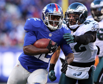 EAST RUTHERFORD, NJ - DECEMBER 30:  David Wilson #22 of the New York Giants carries the ball as  Kurt Coleman #42 of the Philadelphia Eagles defends at MetLife Stadium on December 30, 2012 in East Rutherford, New Jersey. The New York Giants defeated the P