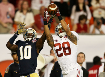 MIAMI GARDENS, FL - JANUARY 07:  Dee Milliner #28 of the Alabama Crimson Tide breaks up a pass intended for DaVaris Daniels #10 of the Notre Dame Fighting Irish causing Ha'Sean Clinton-Dix #6 of the Alabama Crimson Tide to intercept it during the 2013 Dis