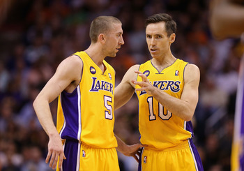 PHOENIX, AZ - MARCH 18:  Steve Nash #10 of the Los Angeles Lakers talks with Steve Blake #5 during the first half of the NBA game against the Phoenix Suns at US Airways Center on March 18, 2013 in Phoenix, Arizona.  The Suns defeated the Lakers 99-76.  NO