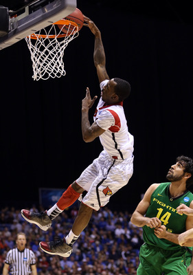 INDIANAPOLIS, IN - MARCH 29:  Russ Smith #2 of the Louisville Cardinals misses a dunk attempt in the second half against Arsalan Kazemi #14 of the Oregon Ducks during the Midwest Region Semifinal round of the 2013 NCAA Men's Basketball Tournament at Lucas