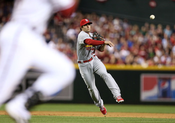 Cardinals' shortstop Pete Kozma throws out a runner at first on Opening Day against the Diamondbacks.