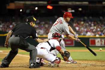 Matt Holliday goes down in the zone and hits a home run against Arizona on April 2.