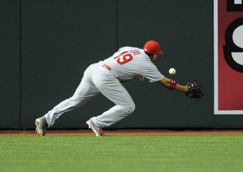 Jon Jay dives for a ball in center field in a game against Arizona, April 3.