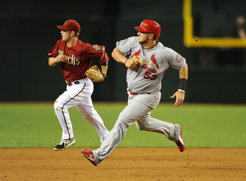 Matt Adams rounds the bases in a game against Arizona on April 2.