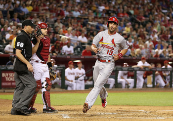 Matt Carpenter crosses home plate in a game against Arizona on April 2.
