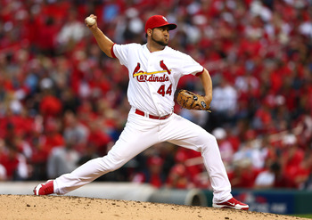 Edward Mujica throws a pitch in Game Three of the NLCS against San Francisco.