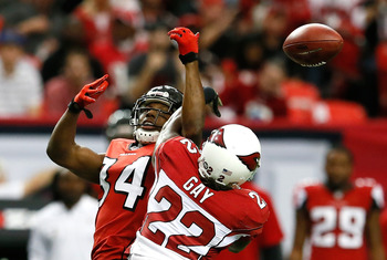 ATLANTA, GA - NOVEMBER 18:  William Gay #22 of the Arizona Cardinals breaks up a reception intended for Roddy White #84 of the Atlanta Falcons that resulted in an interception at Georgia Dome on November 18, 2012 in Atlanta, Georgia.  (Photo by Kevin C. C
