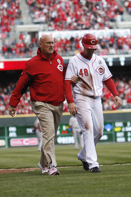 Apr 1, 2013; Cincinnati, OH, USA; Cincinnati Reds left fielder Ryan Ludwick (48) is taken off of the field after injuring his shoulder during the third inning against the Los Angeles Angels at Great American Ball Park. Mandatory Credit: Frank Victores-USA