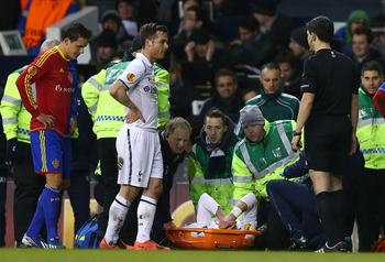 A distraught Gareth Bale lies injured on the ground.