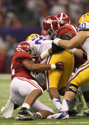 Johnson and the Tide take down an LSU rusher.